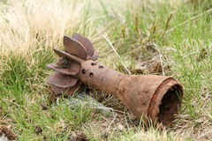 Bomb shell case left in the field Stock Images
