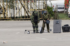 Bomb squad. Modern team of bomb squad preparing to stop a bomb Royalty Free Stock Images