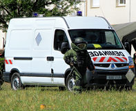 Bomb Squad (Deminage). LAUDUN, FRANCE - MAY 01, 2014: Bomb Squad specialiste and vehicle equipped with a remote-controlled robot, detection and detonation Royalty Free Stock Photos