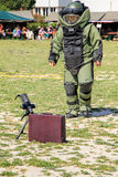 Bomb Squad (Deminage). LAUDUN, FRANCE - MAY 01, 2014: Bomb Squad specialiste and vehicle equipped with a remote-controlled robot, detection and detonation Royalty Free Stock Photo