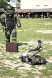 Bomb Squad (Deminage). Bomb Squad specialiste and vehicle equipped with a remote-controlled robot, detection and detonation equipment Stock Image