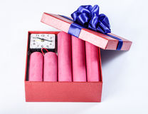 Bomb sticks of dynamite, in a gift box with a blue ribbon with c Royalty Free Stock Photos