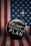 Bomb with Trump`s Immigration Plan word. Image of big bomb with Trump`s Immigration Plan word on the United States flag royalty free stock photography