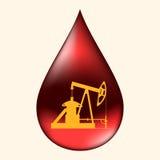 Bomba de óleo em uma gota do óleo Imagem de Stock