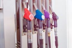 A bomba de combustível com gasolina e diesel segura o distribuidor no posto de gasolina da gasolina fotografia de stock