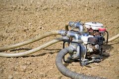 Bomba de água no campo Fotografia de Stock