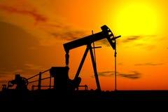 Bomba de petróleo bajo el cielo caliente Foto de archivo