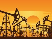 Bomba de petróleo no por do sol Fotografia de Stock Royalty Free