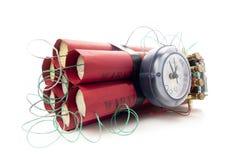 Bomba de relojería de la dinamita en un fondo blanco foto de archivo libre de regalías
