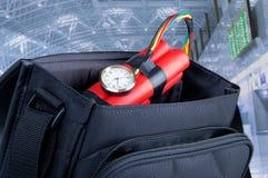 Bomba de relojería en un morral Foto de archivo libre de regalías