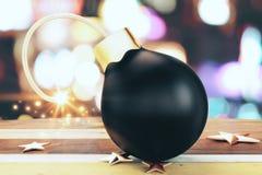 Bomba pequena preta de Christmass com um fusível leve e umas estrelas douradas sobre Fotografia de Stock Royalty Free