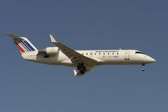 Bombardero CRJ100R Imagenes de archivo