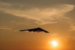 Bombardero de la cautela en la puesta del sol Imágenes de archivo libres de regalías
