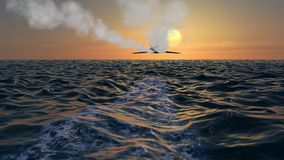 Bombardero Jet Fly Over At Sunset de la cautela Fotos de archivo libres de regalías