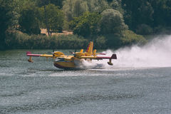 Bombardier 415 amphibious aircraft fire. Bombardier 415 amphibious aircraft, while its water royalty free stock image