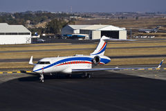 Bombardier BD-700-1A11 Global 5000. Parked on the the apron. FALA — Lanseria International Airport — South Africa royalty free stock photo