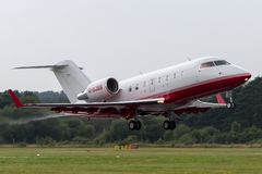 Bombardier Challenger 605 CL-600-2B16 luxury private jet aircraft G-SJSS. Farnborough, UK - July 19, 2014: Bombardier Challenger 605 CL-600-2B16 luxury private royalty free stock images