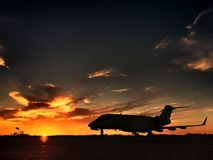 Bombardier CRJ Challenger Charter Jet. Spring sunset. Large charter jet Royalty Free Stock Photo