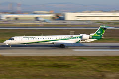 Bombardier CRJ-900 YI-AQB of Iraqi Airways taking off at Ataturk international airport. Istanbul, Turkey - March 18, 2014: Bombardier CRJ-900 YI-AQB of Iraqi Royalty Free Stock Photography