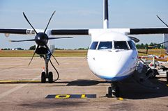 Bombardier Dash 8 Aeroplane, Englqand. Front view of a Bombardier Dash 8-Q402 parked on the apron, East Midlands Airport, Leicestershire, England, Western stock photography