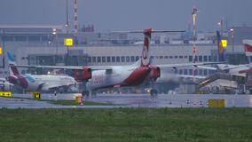 Bombardier Dash 8 of Air Berlin airlines taxiing at the morning. DUSSELDORF, GERMANY - JULY 23, 2017: 4K rear view of Bombardier Dash 8 Q400 of Air Berlin stock video footage
