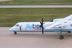Bombardier Dash 8. BIRMINGHAM, UK - APRIL 24, 2013: Pilots taxi Flybe Bombardier Dash 8 Q-400 at Birmingham Airport, UK. Flybe carried 7.6 million passengers in stock image