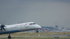Bombardier Dash 8 take-off. FRANKFURT AM MAIN, GERMANY - SEPTEMBER 5, 2015: Austrian Airlines Bombardier Dash 8 OE-LGH take-off on runway 18. Unofficial spotting stock footage