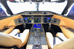 Bombardier Global 6000 business jet cockpit at Singapore Airshow. SINGAPORE - FEBRUARY 16:  Bombardier Global 6000 business jet cockpit at Singapore Airshow Royalty Free Stock Photo
