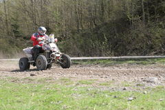 BOMBARDIER Rally quad. Rally quad driver with high speed over the gravel ground. Dakar Series Central Europe Rally Stage 2 - Monday 21 April 2008 Baia Mare Royalty Free Stock Photo