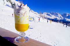 Bombardino with whipped cream on the mountain slopes. In Italy stock photos