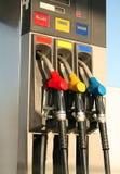 Bombas de gas en la gasolinera Fotografía de archivo libre de regalías
