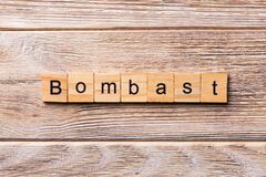 Bombast word written on wood block. bombast text on wooden table for your desing, concept.  royalty free stock images
