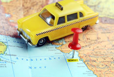 Bombay India map taxi. Close up of Bombay India map with red pin and taxi car - travel concept stock photography