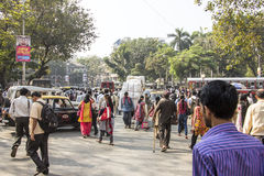 Bombay, street scene. The usual indian chaos: thousands of people, taxis, buses and all kinds of transport Stock Images