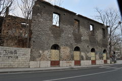Bombed and Bullet tracks on facades of buildings, Bosnia war, Feb`13 Royalty Free Stock Images