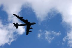 Bomber 1. Picture of a quadrimotor bomber against a blue sky with white clouds Stock Photography