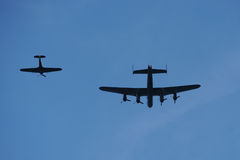 Bomber and Escort. Photograph of a world war 2 bomber and escort sihlouetted against the sky Stock Photos