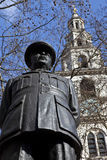 Bomber Harris Statue and St Clement Danes Church. A statue of former RAF leader Bomber Harris with St Clement Danes Church (Central Church of the Royal Air Force royalty free stock photography