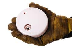 Bombero con el detector de humos Imágenes de archivo libres de regalías