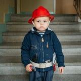 Bombero del niño pequeño Fotografía de archivo libre de regalías