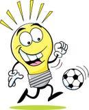 Bombilla de la historieta que juega a fútbol. Imagen de archivo