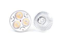 Bombilla del punto del halógeno contra bulbo del ahorro de la energía del LED Fotografía de archivo libre de regalías