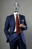 Bombilla en el hombre de negocios - concepto de la solución Fotos de archivo