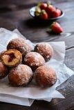 Bomboloni - Italian doughnuts stuffed with strawberry jam Stock Photography