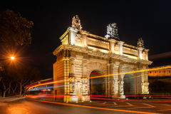 Bombs` Gate in Floriana Malta. 18th Century Bombs` Gate in Floriana, Malta, just outside capital Valletta. Light trails of passing  city bus because of the long Stock Photos