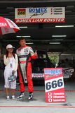 Bomex Porsche team garage, SuperGT 2010. Bomex Porsche 666 team garage, SuperGT round 4 Sepang @ June 2010. Spectator taking photo together with Bomex team lead Royalty Free Stock Image