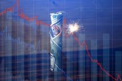 Bomgeld met een brandende wiek met dalingsgrafieken op blauwe achtergrond Explosie van investeringsmarkten Financi?le crisis royalty-vrije stock foto