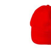 Boné de beisebol vermelho com o espaço vazio para o texto da inserção Fotografia de Stock