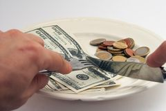 Bon appetit!. Banknotes and coins on a plate as a meal Stock Photos