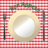 Bon Appetit. Fork, knife, plate on a tablecloth in Italian style Royalty Free Stock Images
